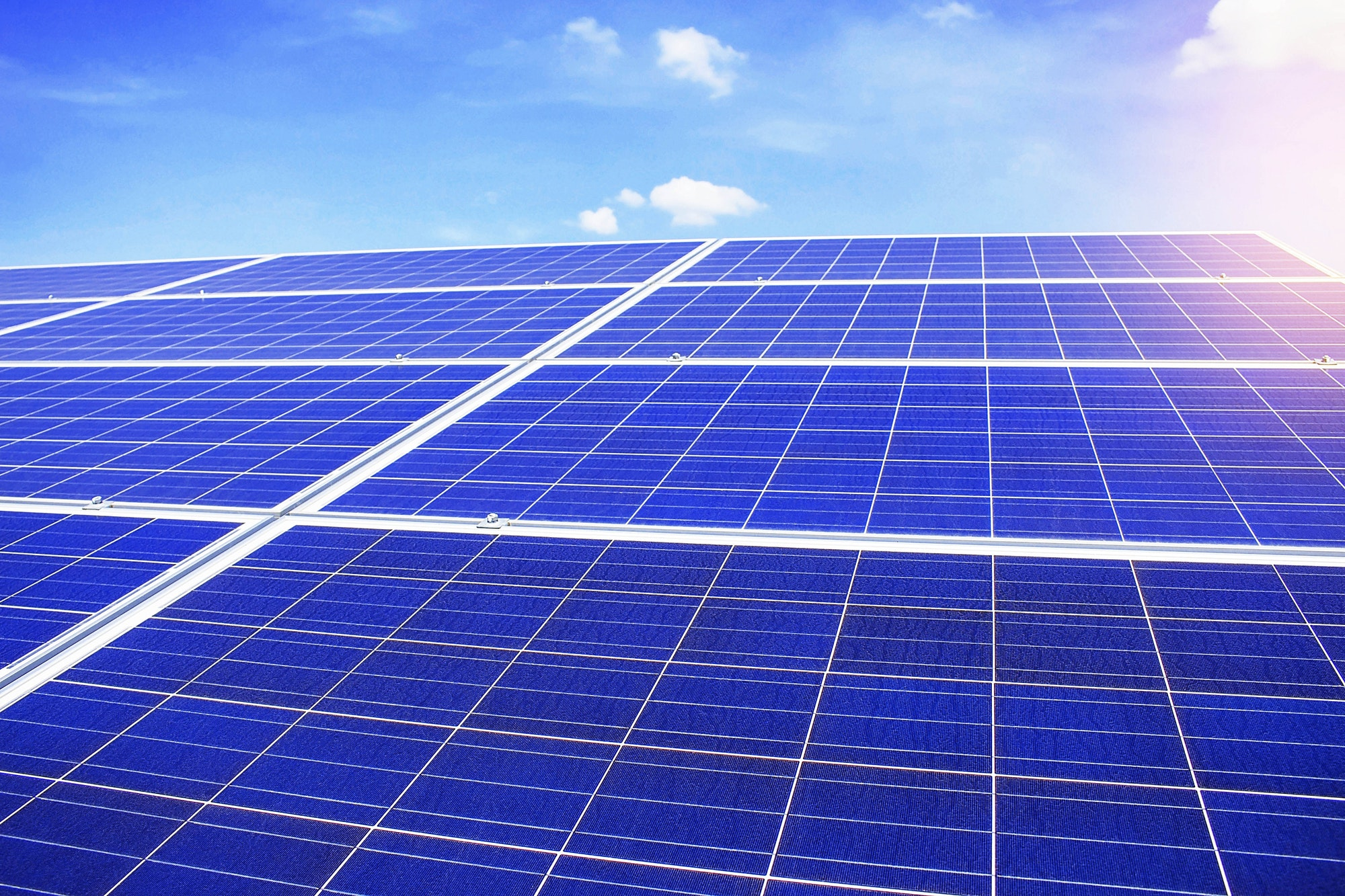 solar panels with the blue sky