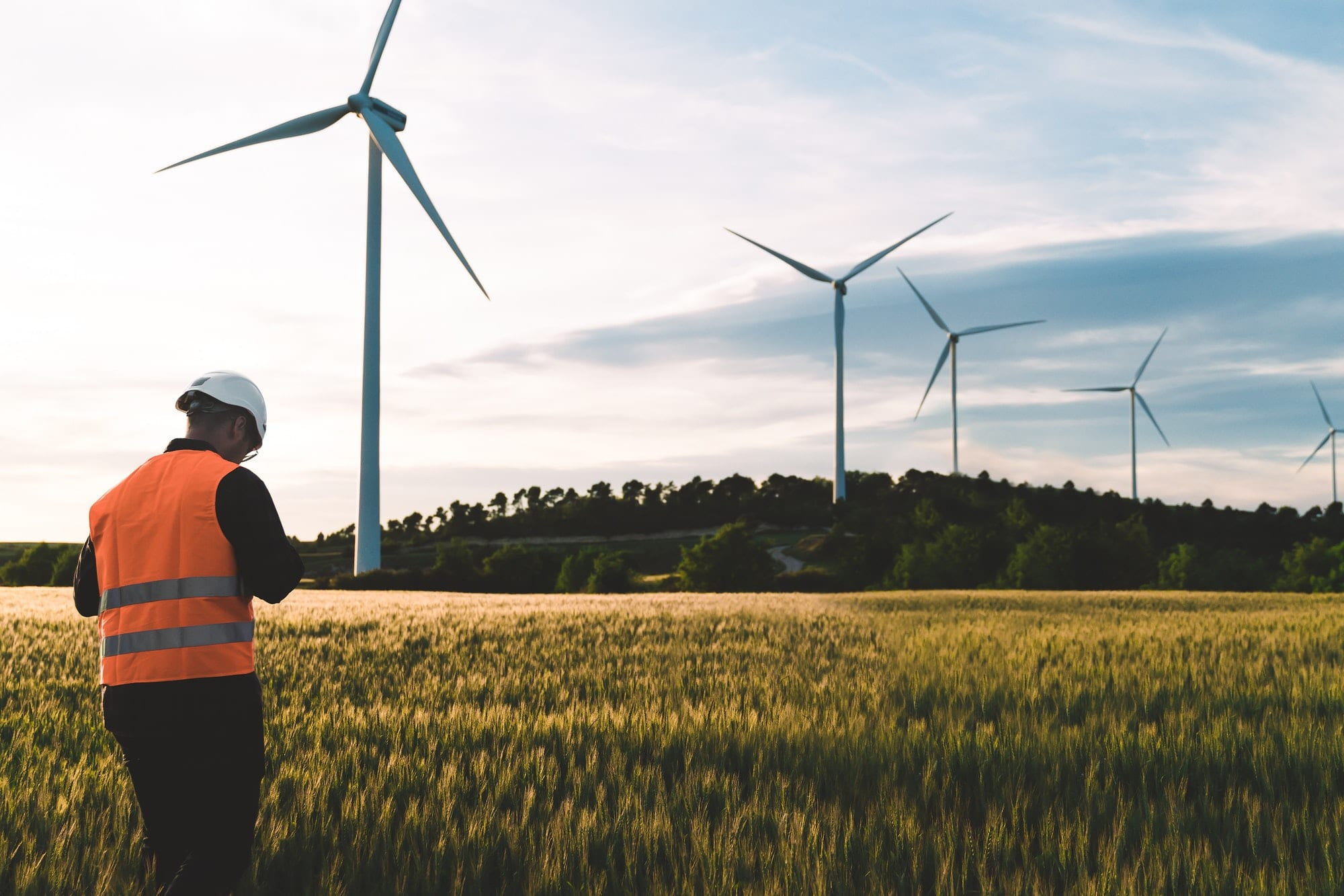 engineer working at alternative renewable wind energy farm sustainable energy industry concept
