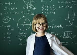 Young scientist girl with blackboard background